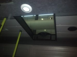 manual escape hatch assembled with long side against vehicle direction on a  minibus