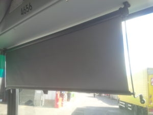 manual guided rollerblind on a city bus  windshield