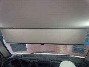 manual scissor sunshade on a rvi windshield