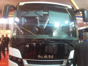 two indipendent scissor shades on a high coach windshield
