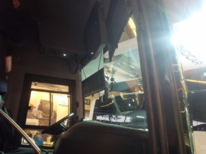 two indipendet scissor electric blinds on a coach windshield